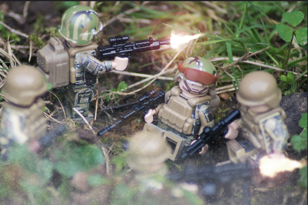 LEGO Body Armour - Image of British and American Soldier LEGO Minifigures using BrickArms weapons, with SI-Dan equipment thrown in.