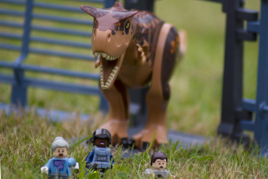 Image of LEGO Carnotaurus chasing minifigures. LEGO Jurassic June.